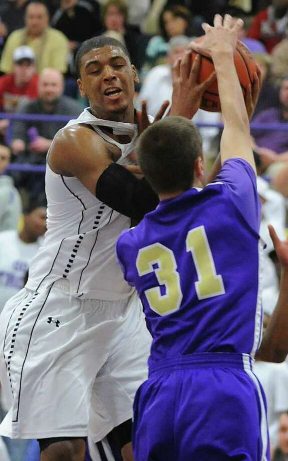 Troy's Trahmier Burrell battles with CBA's Drew Brundige during a basketball game on Tuesday, Feb. 7, 2012 in Troy, N.Y.   (Lori Van Buren / Times Union) Photo: Lori Van Buren