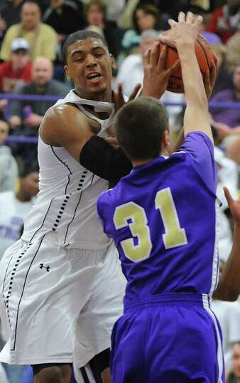 Troy's Trahmier Burrell battles with CBA's Drew Brundige during a basketball game on Tuesday, Feb. 7