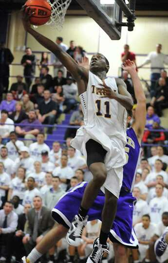 Troy's Trahmier Burrell goes up for two points during a basketball game against CBA on Tuesday, Feb.
