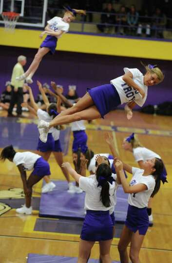 Troy cheerleaders entertain the crowd at halftime during a basketball game against CBA on Tuesday, F