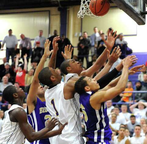Troy players battle for a rebound with CBA players during a basketball game on Tuesday, Feb. 7, 2012 in Troy, N.Y.   (Lori Van Buren / Times Union) Photo: Lori Van Buren