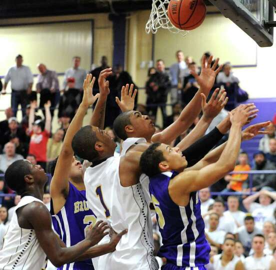 Troy players battle for a rebound with CBA players during a basketball game on Tuesday, Feb. 7, 2012