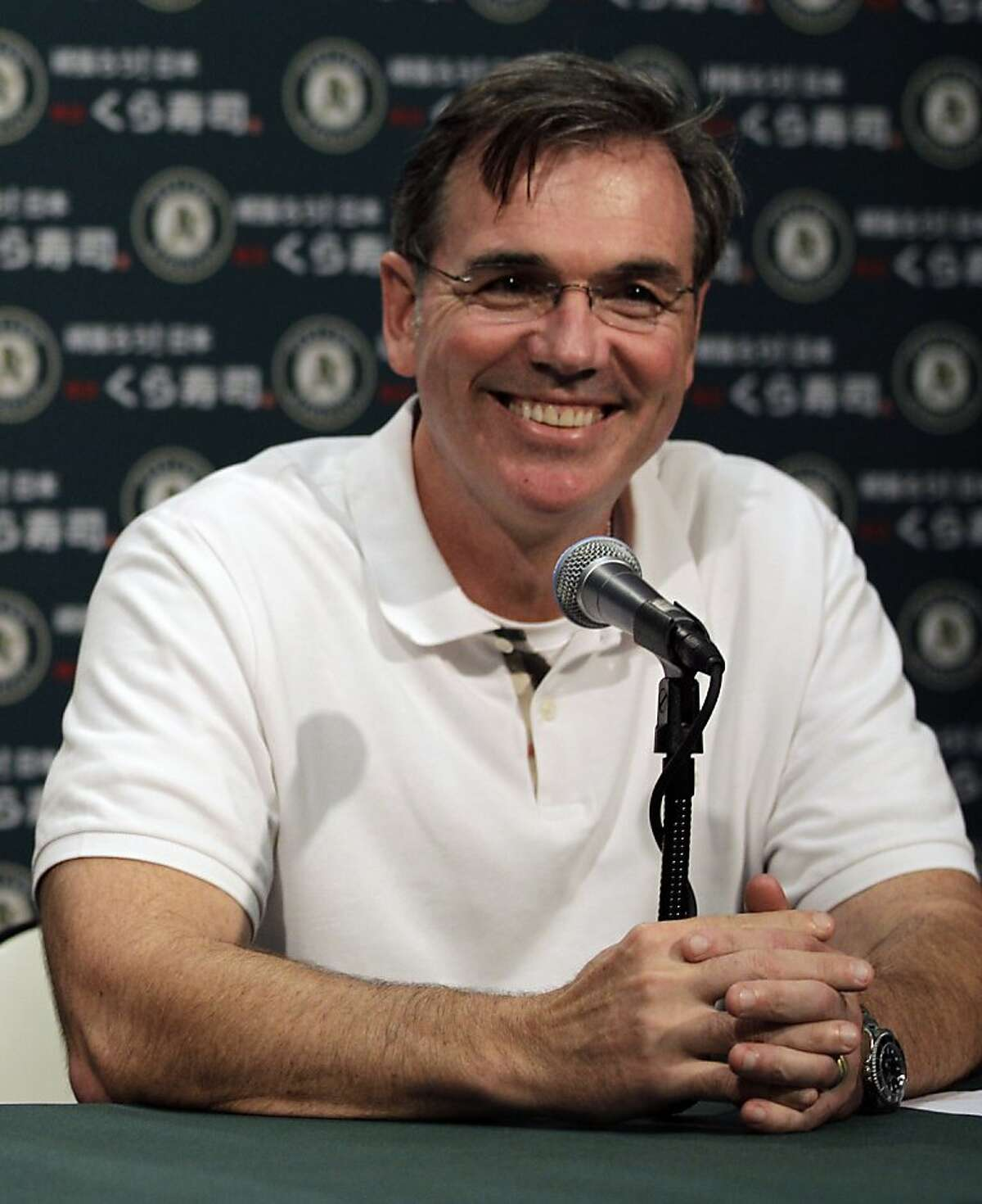 Oakland Athletics general manager Billy Beane smiles during a media conference Wednesday, Sept. 21, 2011, in Oakland, Calif. The Oakland Athletics have reached agreement on a three-year contract to keep Bob Melvin as their permanent manager. The 49-year-old Melvin took over in an interim capacity for the fired Bob Geren in June and has a 42-49 record after Tuesday night's 7-2 loss to the AL West-leading Texas Rangers at the Coliseum. Geren's dismissal marked the first time Oakland fired a manager during the season in a quarter century.