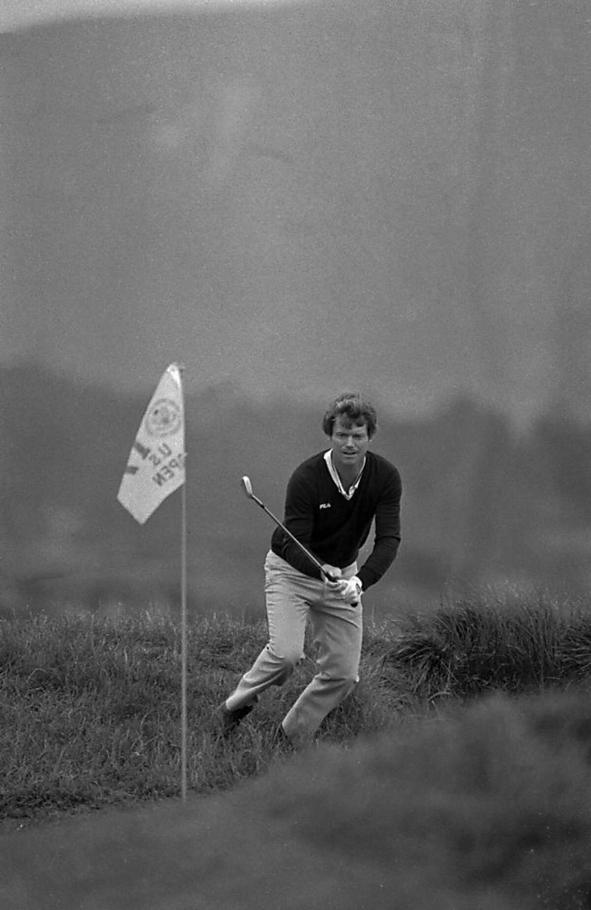 Tom Watson watches his ball go in the hole after hitting out of the rough to sink a birdie two on the 17th hole at Pebble Beach, Calif. during the U.S. Open on June 21, 1982. (AP PHOTO)