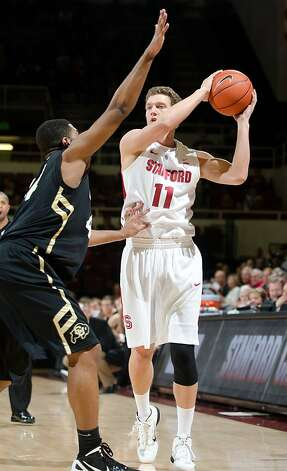STANFORD, CA - January 14, 2012: Stanford's Andy Brown looks to pass against Colorado on Jan. 14 in Stanford, California. Stanford defeated Colorado 84-64. STANFORD, CA - January  14, 2012: Stanford Men's Basketball defeated Colorado 84-64 on January 14th, 2012 in Stanford, California. Photo: Dani Vernon, Stanford Athletics