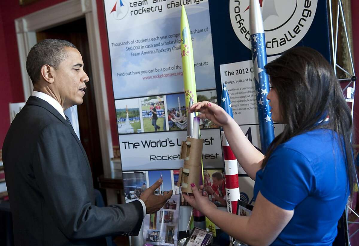 US President Barack Obama talks with Ana Nieto of Presidio, Texas, about her team's rockets and rocketry challenges they have completed, during a tour of the White House Science Fair in the State Dining Room of the White House in Washington, DC, February 7, 2012. Obama announced new policies to recruit and support science, technology, engineering and math (STEM) teacher programs, including requesting $80 million in his upcoming budget for teacher preparation, with the goal of training one million additional STEM students over the next decade.