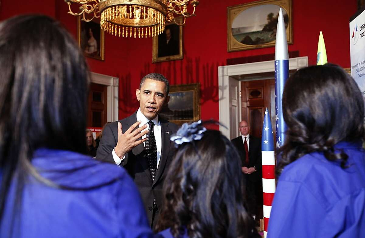 U.S. President Barack Obama speaks to members of Team America Rocketry Challenge (TARC), of Presidio, Texas, while touring student science fair projects on exhibit in the State Dining Room at the White House February 7, 2012 in Washington, DC. Obama hosted the second White House Science Fair celebrating the student winners of science, technology, engineering and math (STEM) competitions from across the country.