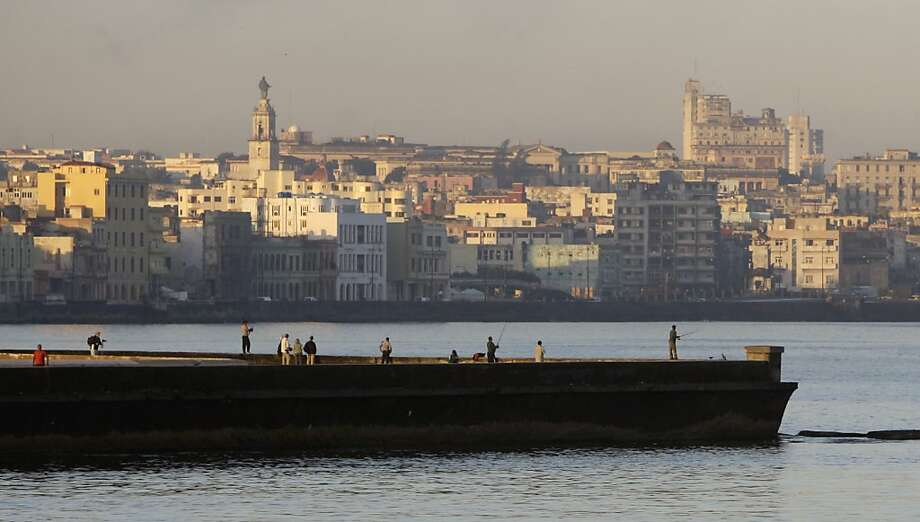 People fish from a dock in Havana Bay, Cuba, Tuesday Feb. 7, 2012. The United States economic embargo on Communist-run Cuba turned 50 Tuesday. Photo: Franklin Reyes, Associated Press