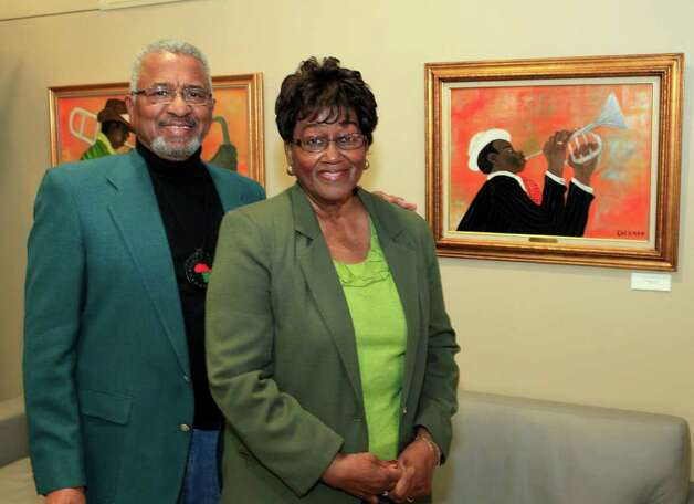 Featured artist John Coleman and Shirley Coleman. In celebration of Black History Month, Port San Antonio partnering with the Women's Pavilion at HemisFair Park hosts the opening reception for Mayor Lila Cockrell's African American Art Collection, Thursday, February 2, 2012. Photo: J. Michael Short , For The Express-News / The San Antonio Express-News