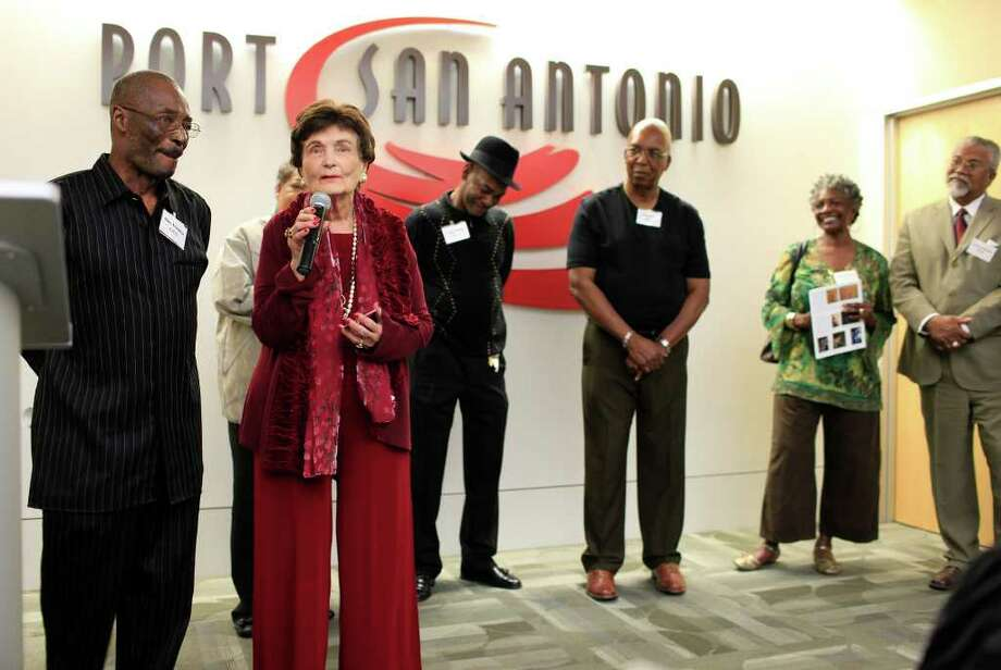 "From the left, artists Glen ""Frank"" Franklin, Claudette Hopkins, Mayor Lila Cockrell, Ronnie Stevens, Paul Hurd, Gracie Poe, Anthony Edwards take to the stage as Cockrell introduces the artists to the assembled crowd. In celebration of Black History Month, Port San Antonio partnering with the Women's Pavilion at HemisFair Park hosts the opening reception for Mayor Lila Cockrell's African American Art Collection, Thursday, February 2, 2012. Photo: J. Michael Short , For The Express-News / The San Antonio Express-News"
