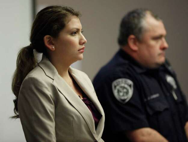 Jenny Ybarra stands Tuesday, Feb. 7, 2012 as the jury enters the 437th District Court at the Cadena Reeves Justice Center during her intoxication manslaughter trial for the death of Erica Nicole Smith. Photo: William Luther, San Antonio Express-News / © 2012 SAN ANTONIO EXPRESS-NEWS