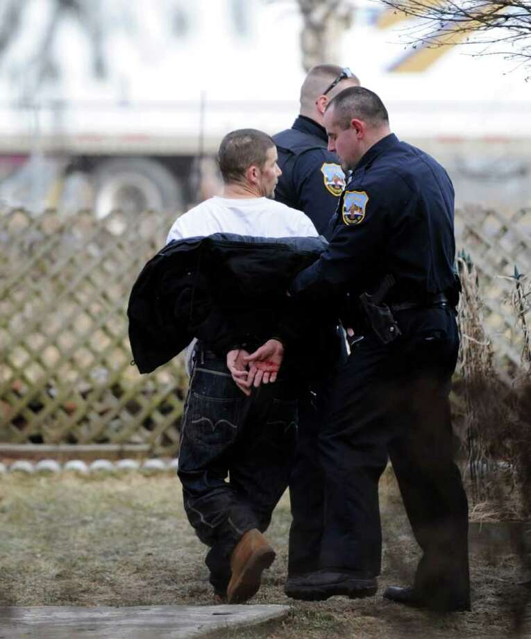 Schenectady police take a man into custody on Strong Street after a car and foot chase that involved the State Police on Wednesday, Feb. 8, 2012.    (Skip Dickstein / Times Union) Photo: SKIP DICKSTEIN / 2011