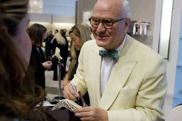 Shoe designer Manolo Blahnik (cq) greets his fans at Neiman Marcus at the Galleria in Houston, Texas Wednesday September 26, 2006. (BILLY SMITH II/STAFF) Photo: Billy Smith II, Staff / Houston Chronicle