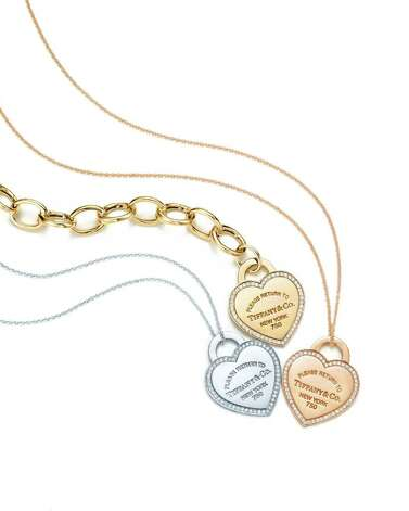 star: Return to Tiffany  heart tag diamond charm bracelet and pendants in 18 karat white, yellow and rose gold. Oval link bracelet in 18 karat gold sold separately. Prices from left: $1,275, $1,100, $1,275. At Tiffany & Co stores and online. Photo: Tiffany & Co.