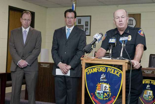 At a press conference at Stamford police headquarters on Friday June 5, 2009, Stamford Police Chief Brent Larrabee discusses agreements made by the police union to meet budgetary requirements. Also participating in the press conference are Stamford Mayor Dannel Malloy (blue tie)  and police union president Sgt. Joseph Kennedy (purple tie). /Shelley Cryan for the Advocate Photo: Shelley Cryan, ST / File
