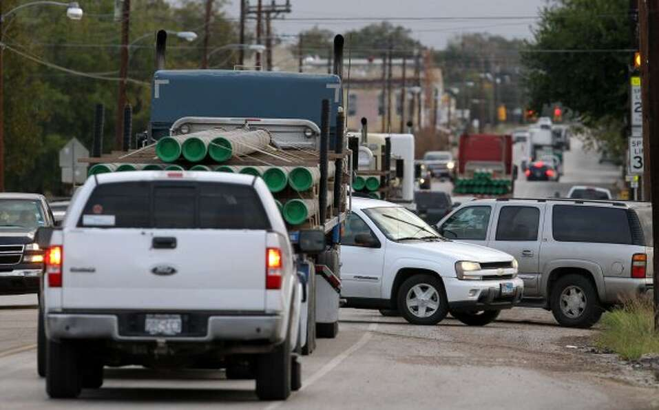 Morning traffic builds Thursday November 17, 2011 at the intersection of State Highway 119 and State