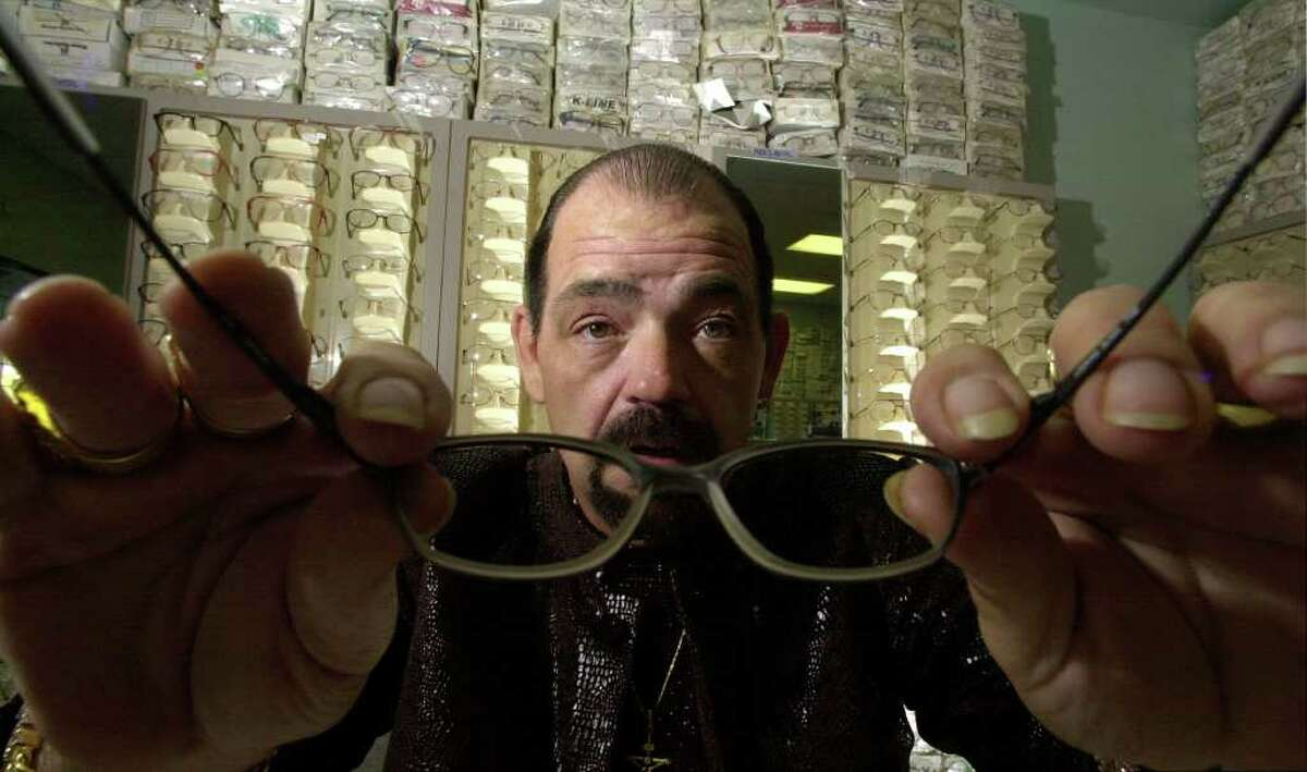 Michael Yuchnitz, owner of the My Econo $39.95 Optical retail glasses chain, poses in his first store on the Southwest Side Thursday, January 3, 2002.
