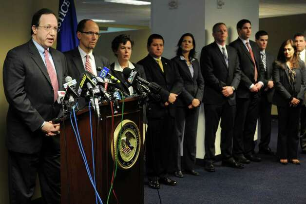 U.S. Attorney David B. Fein, left, speaks about an indictment charging four East Haven police officers with federal civil rights offenses during a press conference in Bridgeport, Conn. on Tuesday, Jan. 24, 2012. Sgt. John Miller and Officers David Cari, Dennis Spaulding and Jason Zullo are accused of harassing and intimidating Latino residents in East Haven, including their advocates, witnesses and other officers who tried to investigate or report misconduct.  (AP Photo/The Connecticut Post, Ned Gerard)  MANDATORY CREDIT Photo: Ned Gerard, Associated Press / Connecticut Post