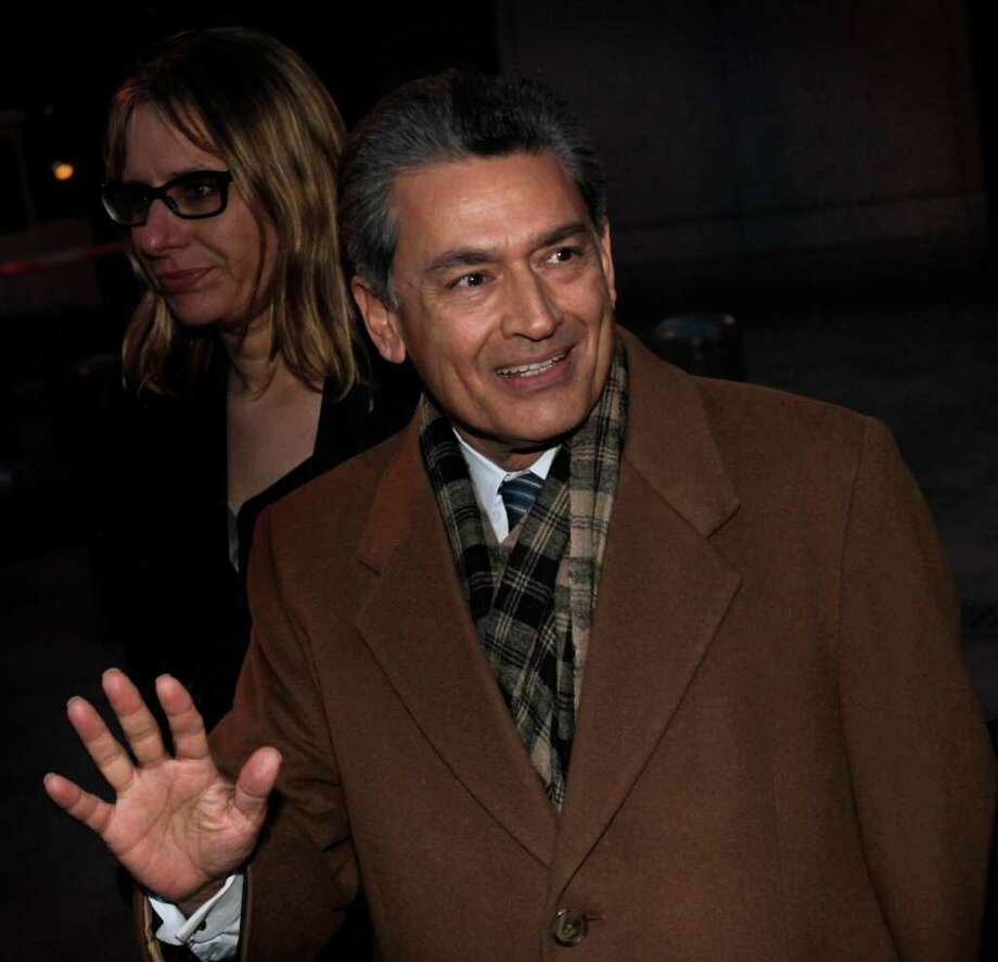 Former Goldman Sachs board member Rajat Gupta exits Manhattan federal court after a pre-trial hearing Thursday, Jan. 5, 2012 in New York. Gupta, of Westport, was charged last year with conspiracy and securities fraud. Free on $10 million bail, his trial was moved to May 21 from April 9 by U.S. District Judge Jed Rakoff. (AP Photo/Seth Wenig) Photo: Seth Wenig, Associated Press / AP