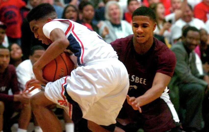 H-J's Devante Johnson steals the ball from Silsbee's Kelton Gaines at Hardin-Jefferson High School i