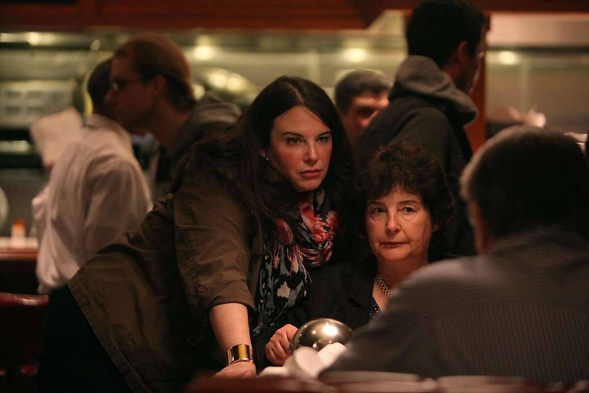 Elena Duggan (left) and her mother Marie Duggan (right) talking with Larry Browning (back facing) in the newly opened Original Joe's in San Francisco, Calif., on Thursday, February 2, 2012.
