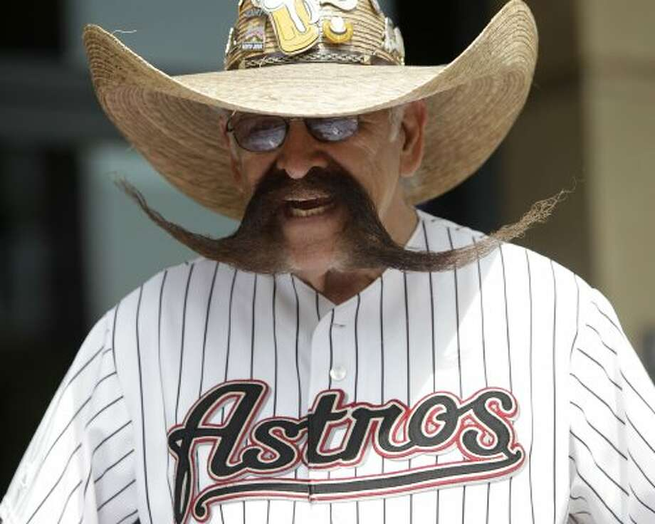 Valentin Jalomo, of Houston, sports his mustache and Astros jersey as fans participate in the Astros' 10th annual opening day street festival before the start of the Astros home opener against the Marlins. (Karen Warren / Houston Chronicle)