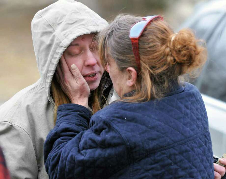 Jessica Clyde, left,28, of Petersburg, missing since Monday  morning, is reunited with her mother Terri Clyde outside the Town Hall offices in Petersburg Wednesday Feb. 8, 2012.    (John Carl D'Annibale / Times Union) Photo: John Carl D'Annibale