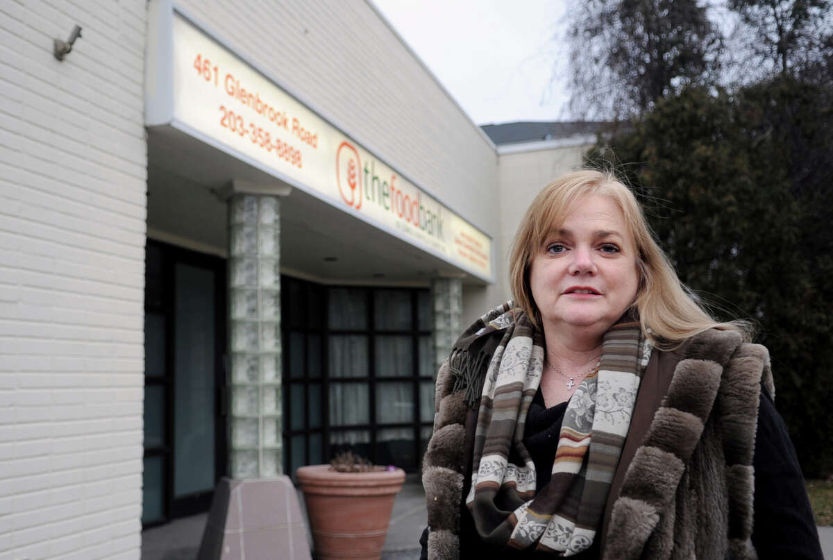 Executive Director Kate Lombardo poses for a photo outside the Food Bank of Lower Fairfield County on Glenbrook Road in Stamford on Wednesday, February 8, 2012, where an American flag was stolen from the outside of the building.