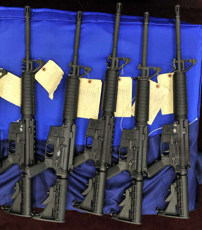 These AK-47 and AR-15 rifles were seized in a recent operation that netted more than 200 firearms. Photo: Robin Jerstad, For The Express-News