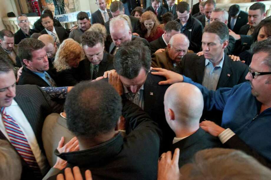 Republican presidential hopeful Rick Santorum, the former Pennsylvania senator, is prayed over after speaking at the Bella Donna Chapel in McKinney. Photo: Rex C. Curry, Associated Press