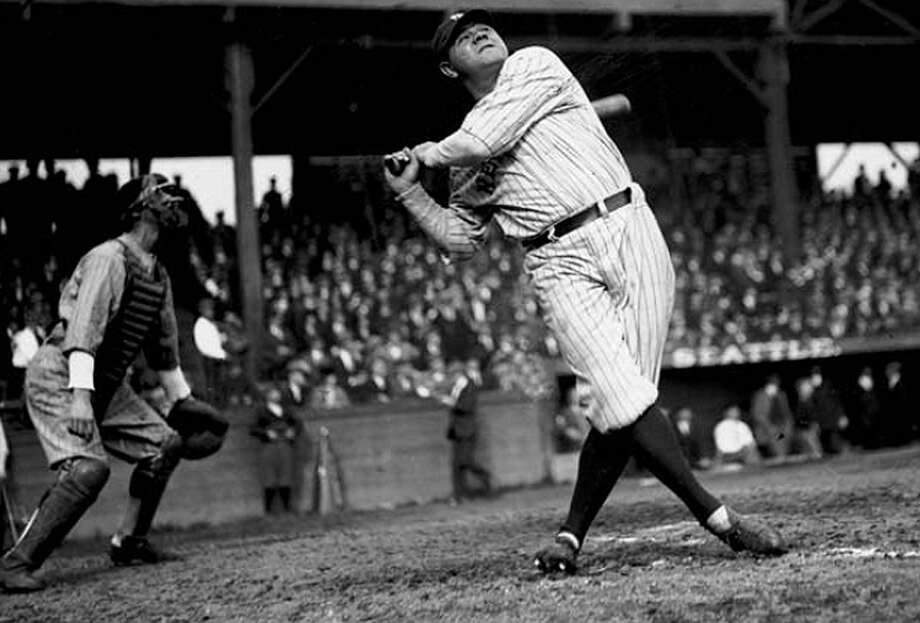 "The Bambino, who made his major league debut in 1914, became famous with the New York Yankees, and made his last major league appearance in 1935, first came to Seattle on Oct. 19, 1924. When his train came to King Street Station fans lined up. P-I columnist Royal Brougham, a friend of Ruth's over the years, was his escort for Ruth's three-day visit here. He even convinced the P-I to pay for the trip, reporter Dan Raley discovered. After a visit to Orthopedic Hospital on Queen Anne Hill, Ruth went to Dugdale Park, now the site of Lowe's Hardware on Rainier Avenue South, where at least 9,000 people gathered. Ruth hit three home runs, including one that went over the right field fence and over a neighboring and a gas station. Read more here. Raley also has more about Ruth and his connection to the Seattle Rainiers in his book ""Pitchers of Beer."" Photo: Seattlepi.com File/MOHAI"