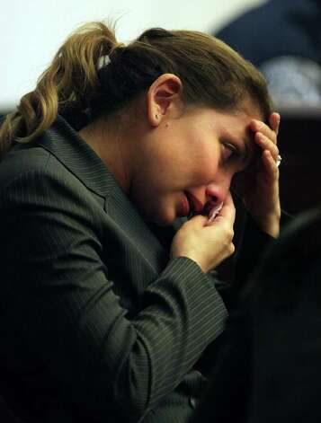 Jenny Ybarra, who is on trial for intoxication manslaughter of Erica Nicole Smith, breaks down in tears as her mother JoAnn Ybarra takes the stand in the 437th District Court in the Cadena Reeves Justice Center, Wednesday, Feb. 8, 2012. Photo: BOB OWEN, San Antonio Express-News / © 2012 San Antonio Express-News