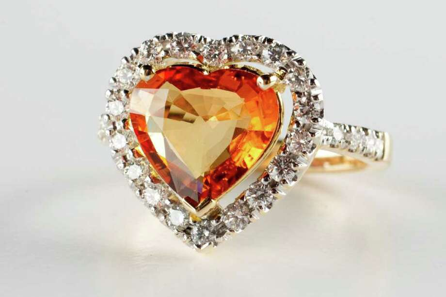 An orange Sapphire heart ring from Houston Jewelry is shown in the Chronicle Studio Tuesday, Feb. 7, 2012, in Houston. ( Brett Coomer / Houston Chronicle ) Photo: Brett Coomer / © 2012 Houston Chronicle