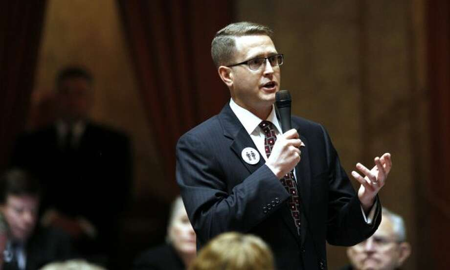 """Rep. Matt Shea, R-Spokane Valley, speaks about a proposed amendment to a gay marriage bill Wednesday, Feb. 8, 2012, in Olympia, A House-sponsored report found that he has """"planned, engaged in, promoted a total of three armed conflicts of political violence in three states outside of the state of Washington . . ."""""""