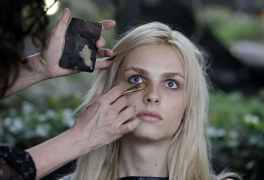 In this Jan. 27, 2012 photo, photographer transgender model Andrej Pejic has make-up applied by Cecelia Romero for a fashion shoot in New York. Transgender models have promoted the work of Marc Jacobs and Jean Paul Gaultier, but it's a man with no plans for gender reassignment surgery who's straddling the line like no other.  Pejic, 20, says he's perfectly happy being gender neutral. Some in the fashion industry see Pejic as a sign of a new gender fluidity. Photo: Richard Drew, Associated Press