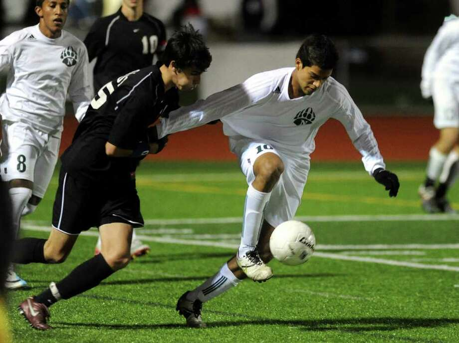 Norwalk's #10 Nicholas Zuniga, right, heads off Trumbull's #5 Zach Chase, during CIAC Boys Soccer State Tournament Class LL Semifinal action in Waterbury, Conn. on Saturday November 19, 2011. Photo: Christian Abraham / Connecticut Post