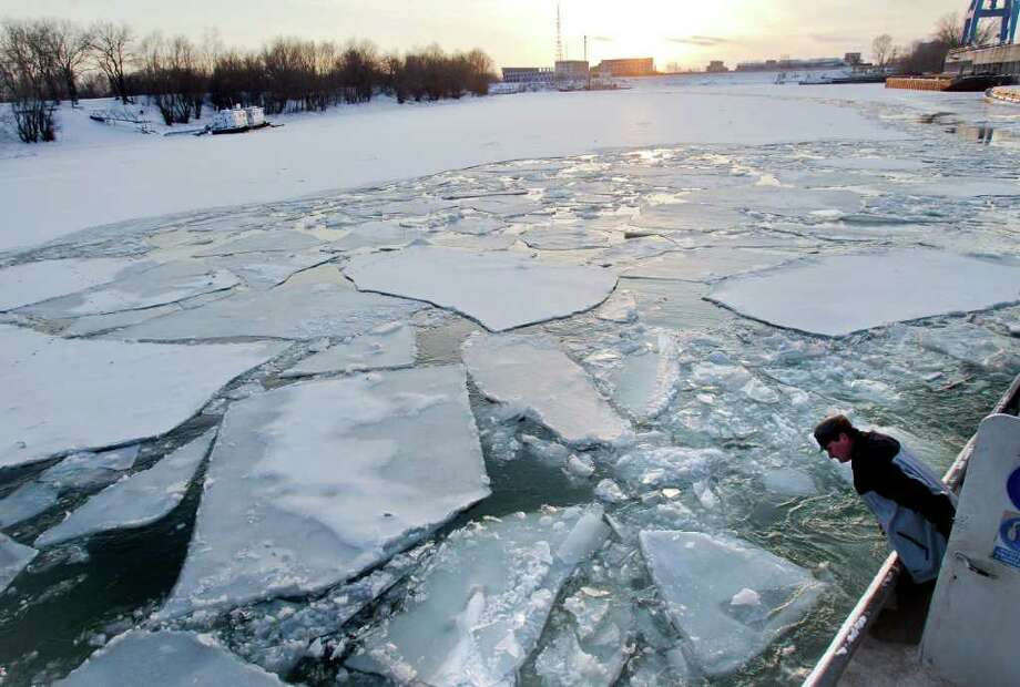 A crew member of an ice breaker surveys the ice as the ship advances in frozen Danube waters, in Giurgiu, southern Romania, Wednesday, Feb. 8, 2012. Photo: Vadim Ghirda, Associated Press / AP