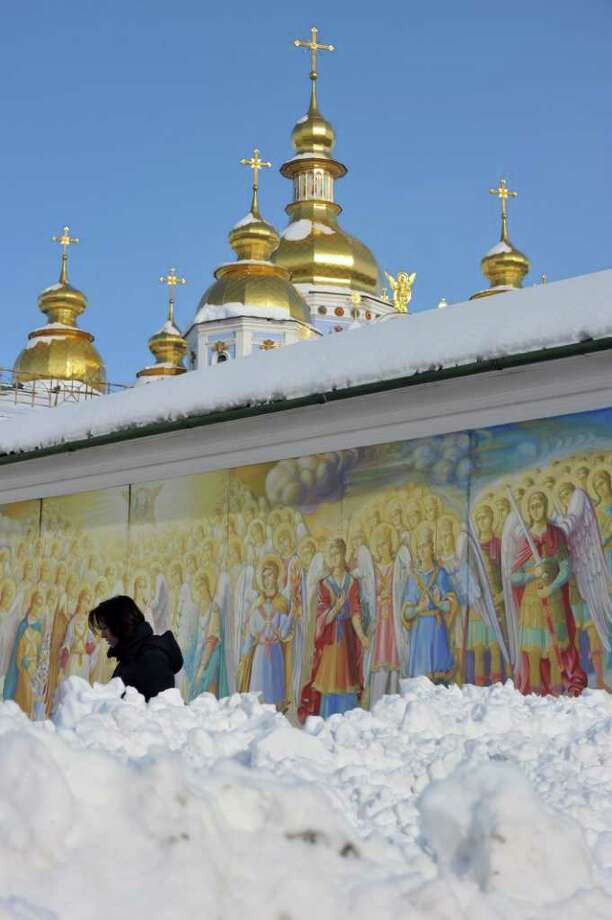 A woman walks in front of Mykhaylo Gold Domes Cathedral in Kiev on February 8, 2012. Photo: SERGEI SUPINSKY, AFP/Getty Images / AFP