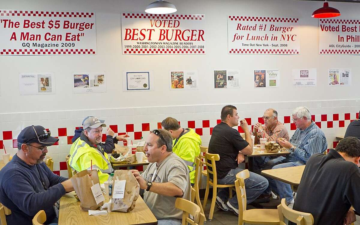 Diners enjoy lunch at Five Guys Burgers in Burlingame, Calif., on Thursday, February 2, 2012.