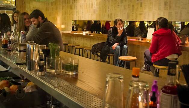 People enjoy cocktails at the Plum Bar in Oakland, Calif., on Thursday, January 19th, 2012. Photo: John Storey