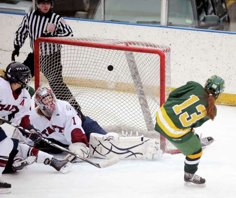 At right, Eva Rosencrans # 13 of Greenwich Academy scores her second goal of the lst period on Taft goalie Colleen Marcik during girls high school ice hockey game between Greenwich Academy and Taft School at the Greenwich Skating Club, Wednesday afternoon, Feb. 8, 2012. Photo: Bob Luckey / Greenwich Time