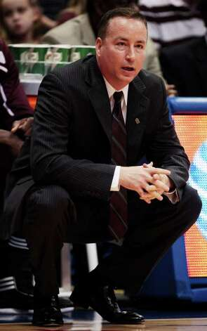 Texas A&M coach Billy Kennedy watches his team during the first half of an NCAA college basketball game against Kansas in Lawrence, Kan., Monday, Jan. 23, 2012. Photo: AP