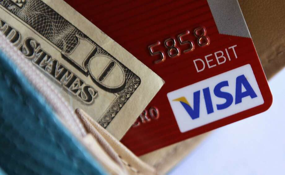 In this photo taken Tuesday, May 3, 2011, a Visa card is displayed with a wallet in Richardson, Texas. Visa Inc., reports quarterly financial earnings Thursday, May 5, after the market close. Photo: LM Otero, AP