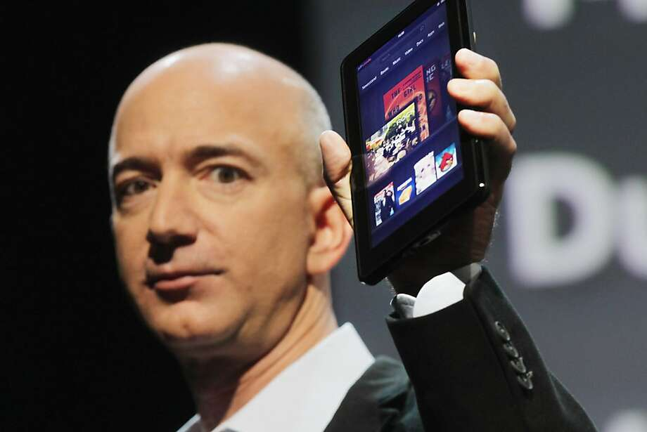 NEW YORK, NY - FILE:  Amazon founder Jeff Bezos holds the new Amazon tablet called the Kindle Fire on September 28, 2011 in New York City.  It was reported that Amazon.com Inc. shares fell 10 percent after sales didn't meet up to expectations February 1, 2012.  (Photo by Spencer Platt/Getty Images) Photo: Spencer Platt, Getty Images