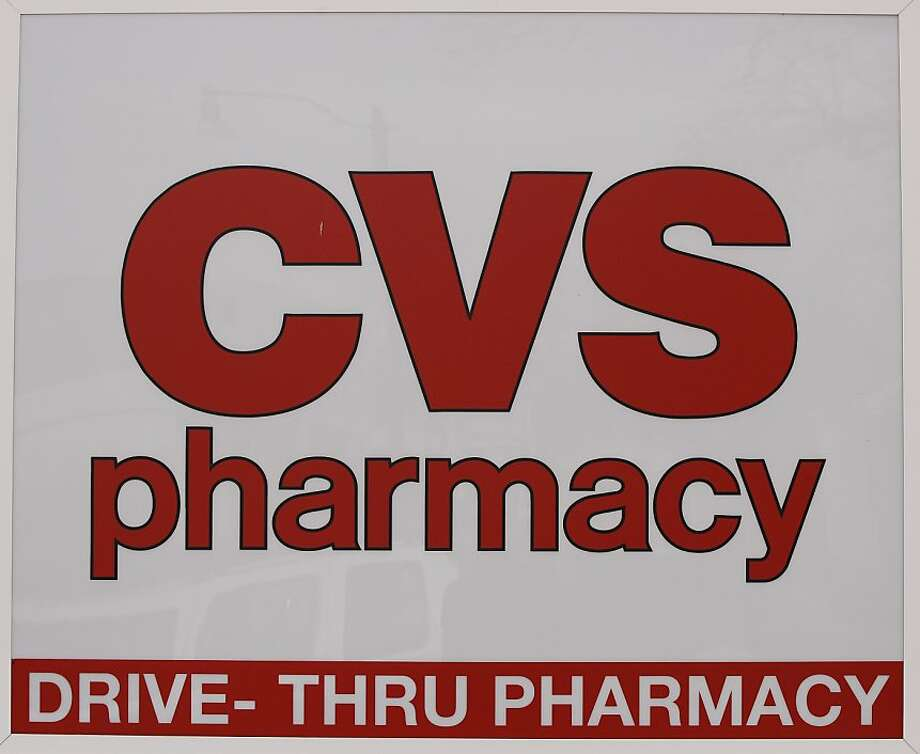 CVS is gaining customers as competitor Walgreens feuds with a major pharmacy benefits manager. Photo: Stephan Savoia, Associated Press