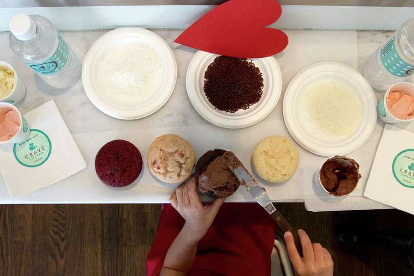 Brouj Al Sulaiti, 6, decorates a cupcake at Crave Cupcakes Wednesday, Feb. 8, 2012, in Houston.