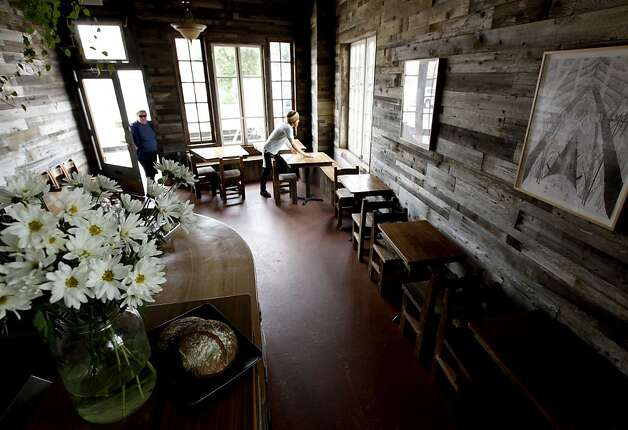 The walls of the dining room at Outerlands are covered with weathered barn wood. Photo: Michael Macor, The Chronicle