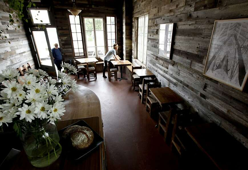 The walls of the dining room at Outerlands are covered with weathered barn wood.