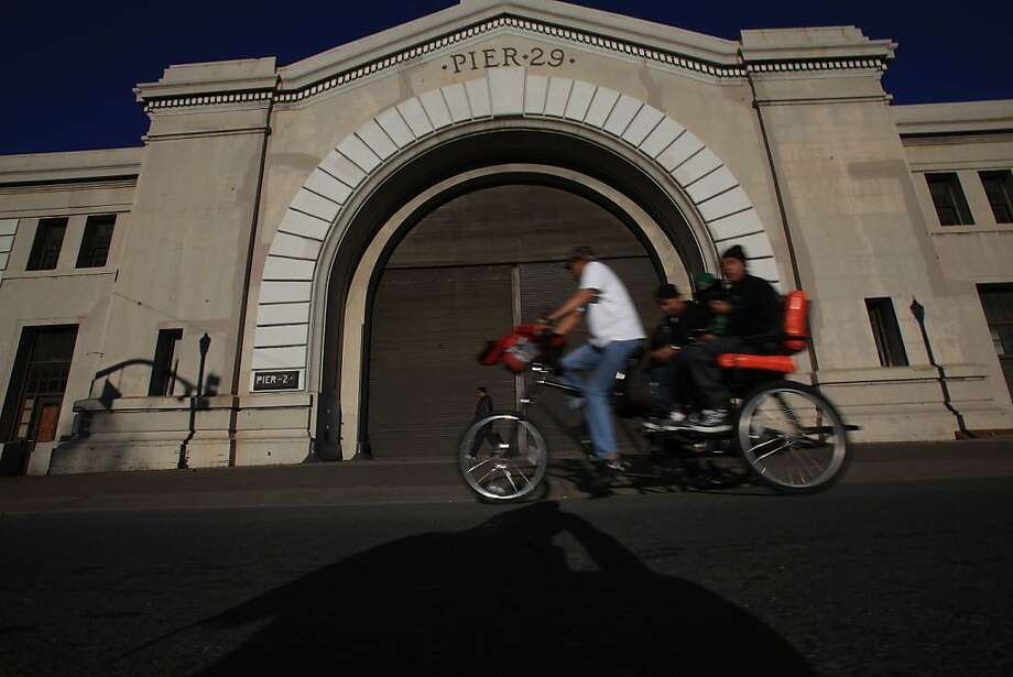 A pedicab cycles past Pier 29 on the Embarcadero on Monday, December 5, 2011 in San Francisco, Calif. Photo: Lea Suzuki, The Chronicle