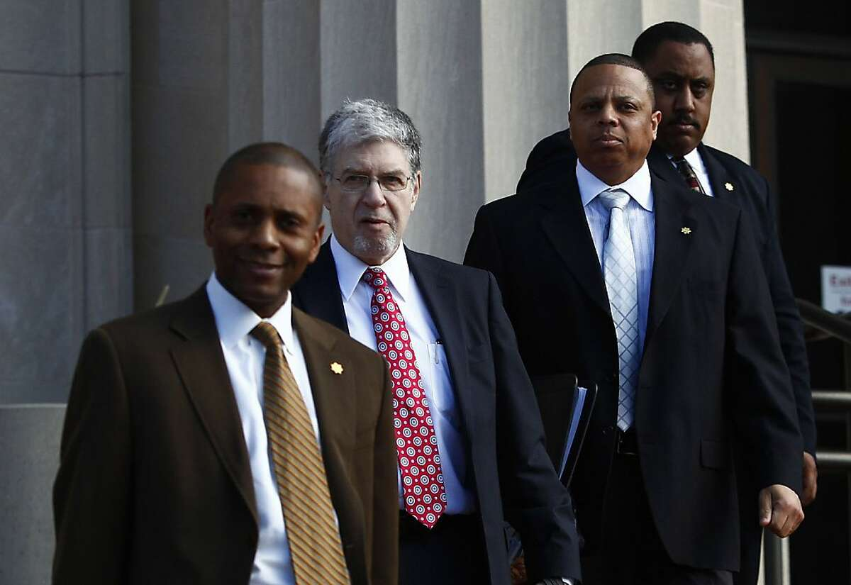 Lt. Arnold Threets, attorney Stephen Jaffe, Lt. Shawn Pickett and Sgt. James Jenkins leave the Justice Wakefield Taylor Courthouse on Wednesday, February 8, 2012 in Martinez, Calif.